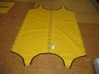 Vinyl Wing Trampolines to fit a Hobie® 18 Magnum catamaran made in America by skilled artisans at SLO Sail and Canvas. Shown in 22oz yellow Vinyl.