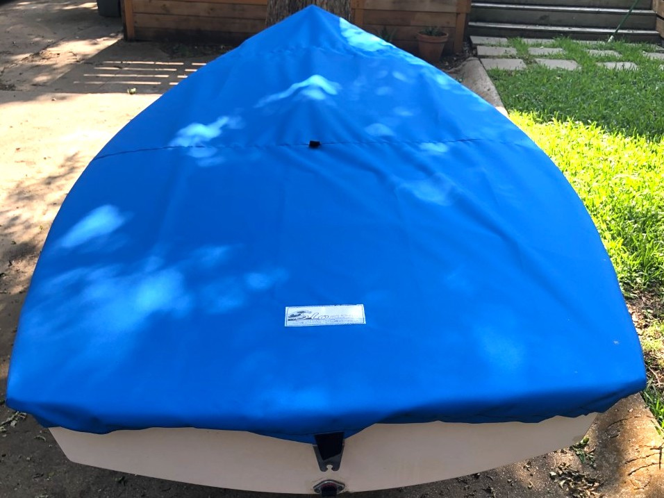 """Force 5 sailboat Top Cover by SLO Sail and Canvas. 1/4"""" shockcord is built into cover to secure your cover tightly around the boat's rubrail. Web Loops allow you to """"tent"""" your cover up to prevent pooling of water."""