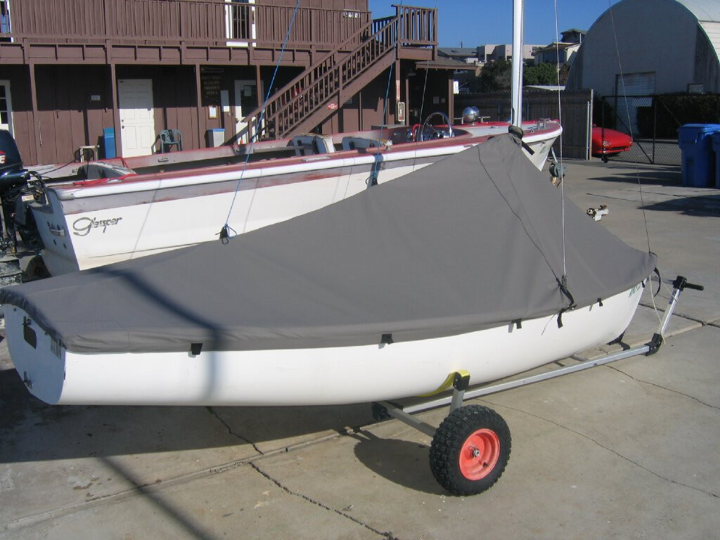 Flying Junior sailboat Mast Up Peaked Mooring Cover made in America by skilled artisans at SLO Sail and Canvas. All of our covers are patterned from the actual boats they are designed to fit. This make for a better, higher quality product.