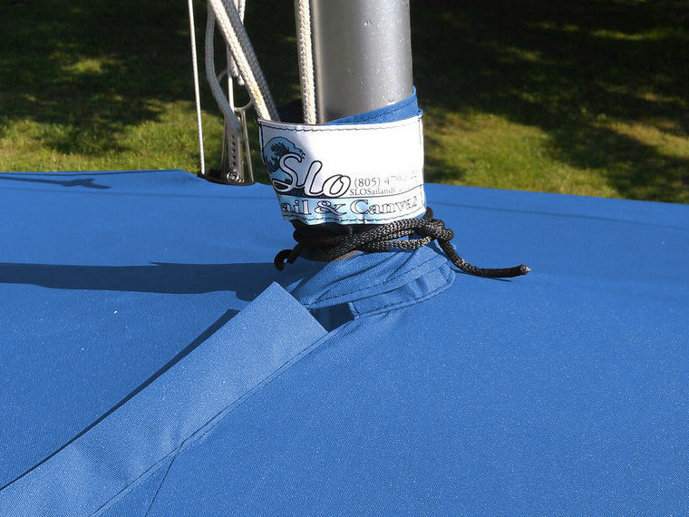 Apollo 16 Mast Up Flat Mooring Cover by SLO Sail and Canvas. A mast collar and perfectly placed shroud cutouts fit tightly around your boat's rigging.