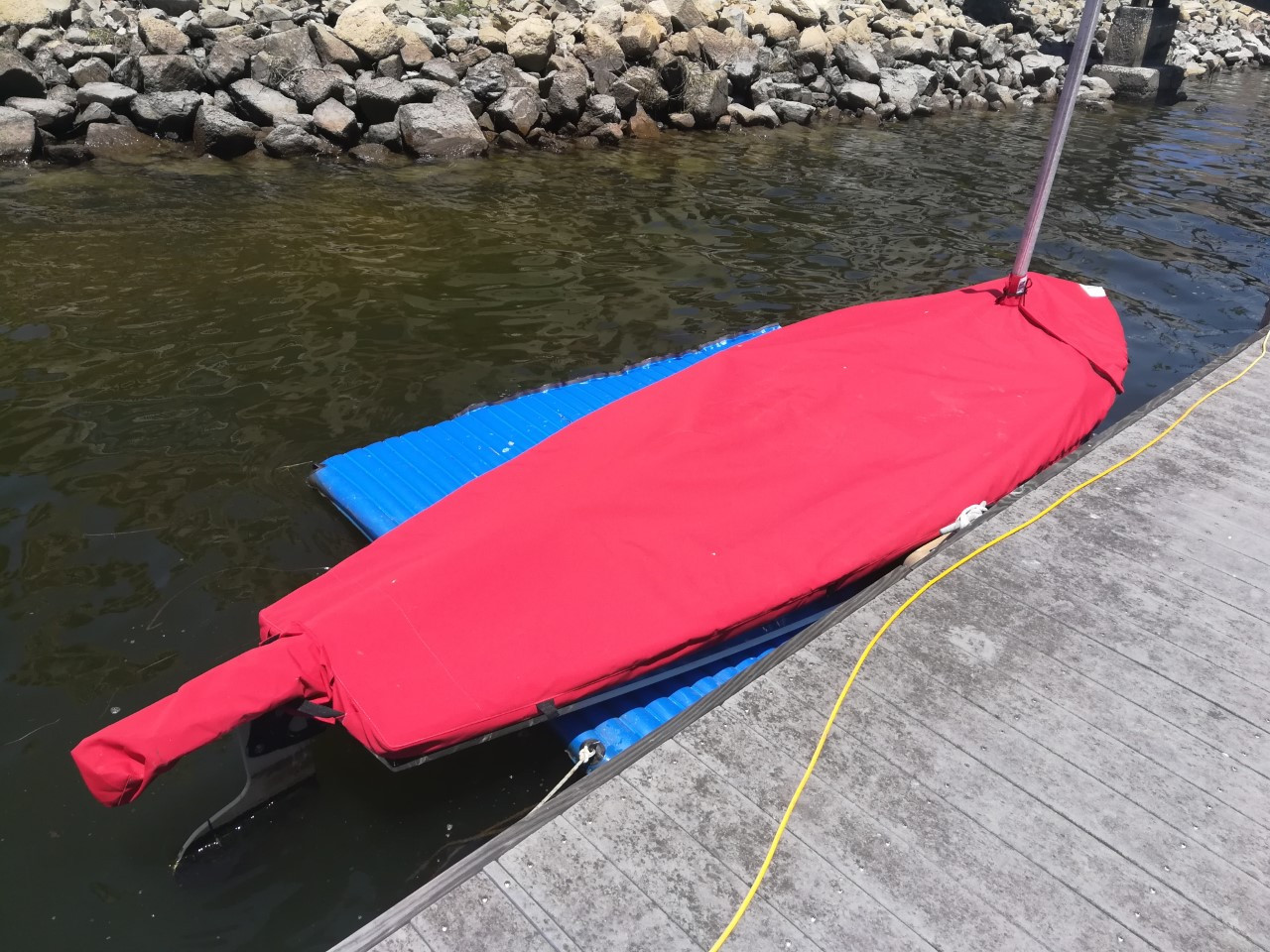 Dolphin Sr. Sailboat Mast Up Flat Cover made in America by skilled artisans at SLO Sail and Canvas. Cover shown in Sunbrella Jockey Red. Available in 3 fabrics and many color choices.