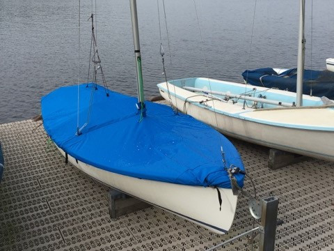 """Sailboat Mast Up Flat Mooring Cover by SLO Sail and Canvas. 1/4"""" shockcord is built into cover to secure your cover tightly around the boat's rubrail. Web Loops allow you to """"tent"""" your cover up to prevent pooling of water."""