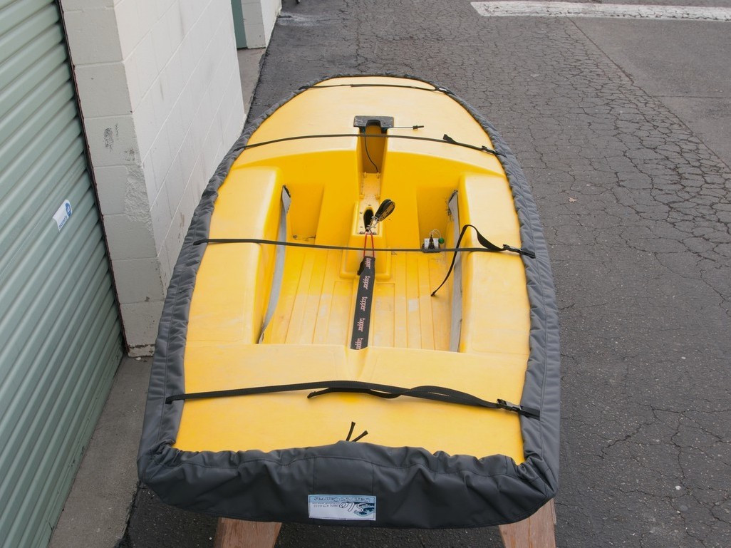 Topper Sailboat Hull Cover made in America by skilled artisans at SLO Sail and Canvas. Polypropylene straps with plastic Fastex buckles.