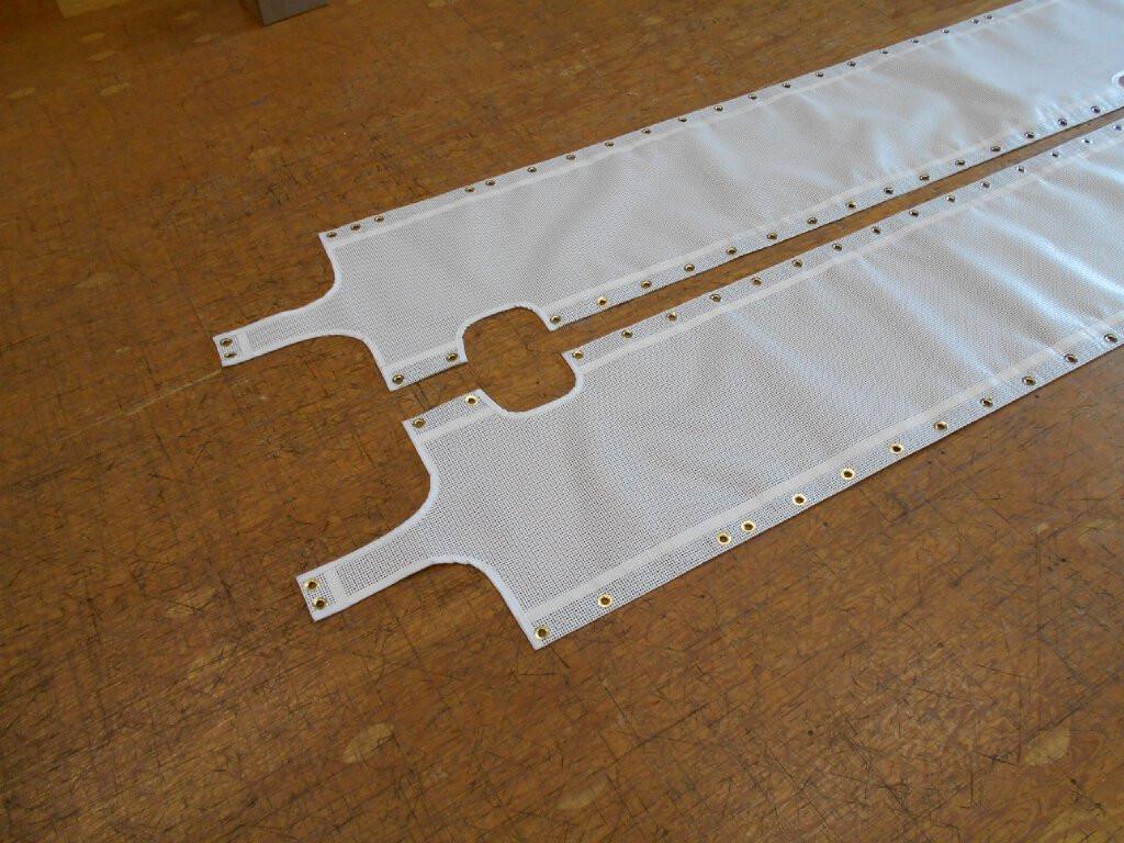 Shown in Ferrari Precontraint 392 white architectural-grade mesh.