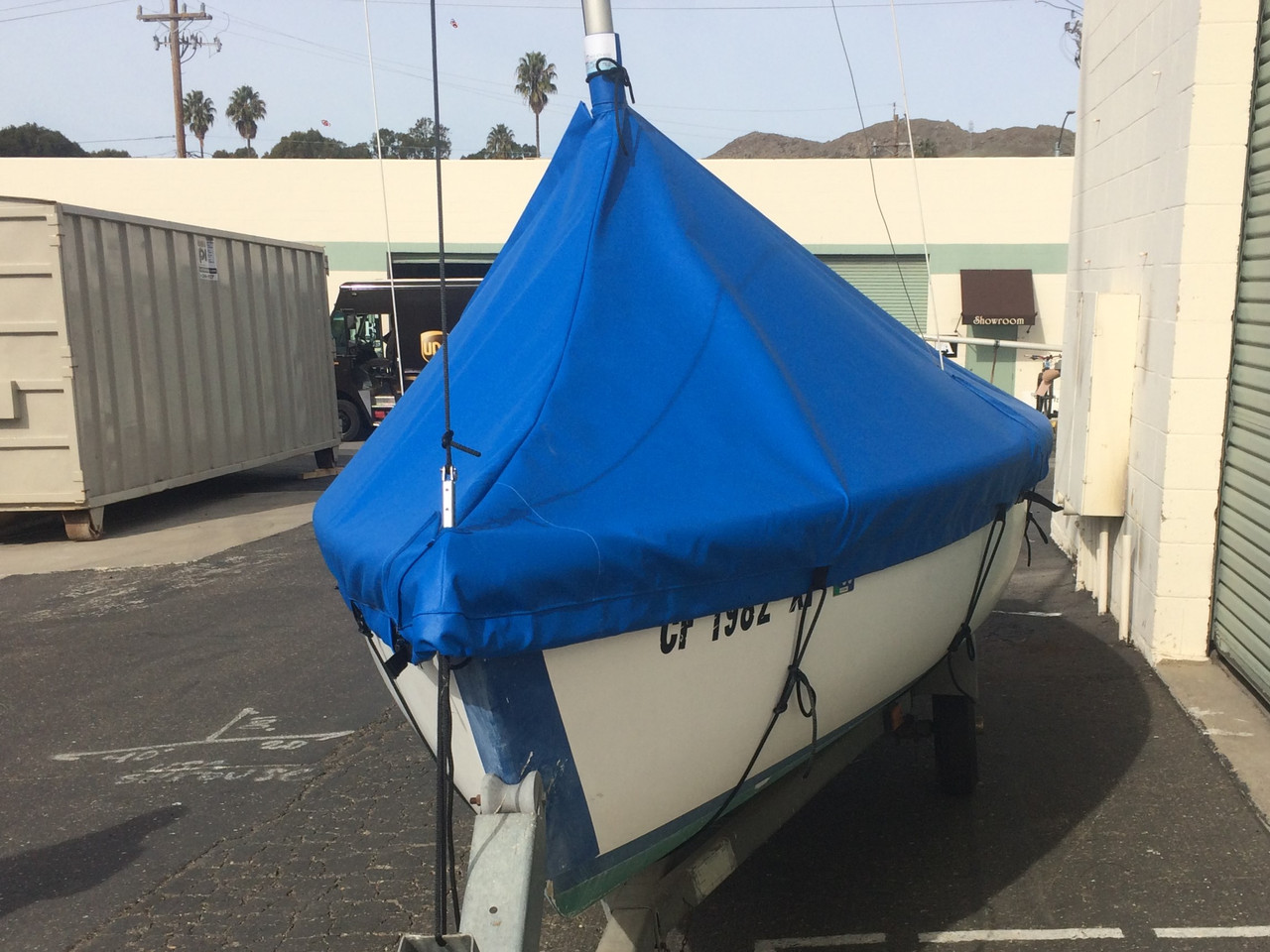 The Catalina 14.2 Mast Up Peaked Cover by SLO Sail and Canvas has custom tailored cutouts for the rigging and the mast.