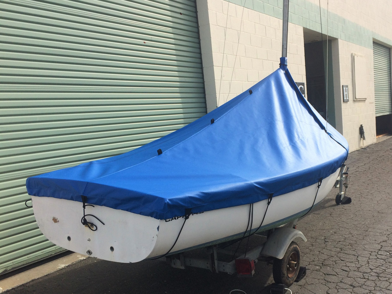 A Mast Up Peaked Cover from SLO Sail and Canvas will shed water and debris - keeping your Capri 14.2 by Catalina clean and ready to sail in minutes.