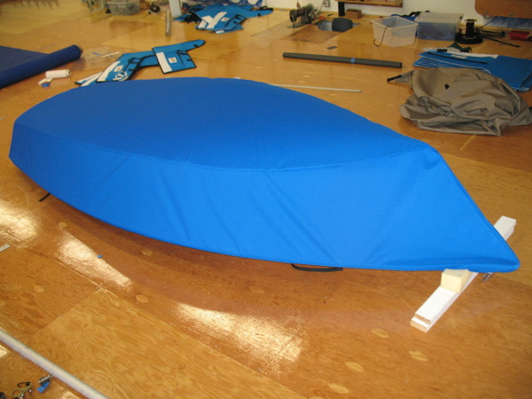 Sailboat Hull Cover made in America by skilled artisans at SLO Sail and Canvas. Cover shown in Polyester Royal Blue. Available in 4 fabrics and many color choices.