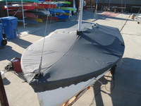 """Sailboat Mast Up Flat Mooring Cover made in America by skilled artisans at SLO Sail and Canvas. 1/4"""" shockcord is built into cover to secure your cover tightly around the boat's rubrail. Web Loops allow you to """"tent"""" your cover up to prevent pooling of water. A mast collar and perfectly placed shroud cutouts fit tightly around your boat's rigging. Reinforcements positioned over blocks and cleats prevent chafing. Webbing loops are sewn around the perimeter of our top covers allowing your cover to be tied to your boat. All of our covers are patterned from the actual boats they are designed to fit. This make for a better, higher quality product."""