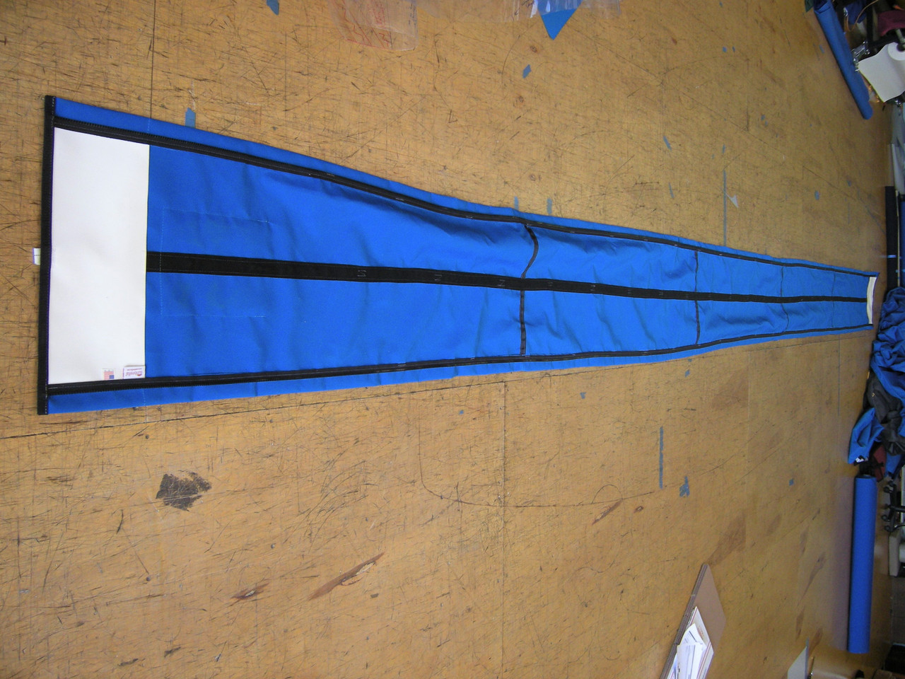 Zippers enclose SLO Sail and Canvas Jib Snorkel sail covers to your sail. Close them as they are hoisted.