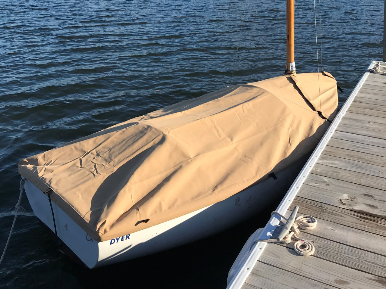 Keep your Dyer Dink dinghy free of leaves and dirt with a Mast Up Flat Cover by SLO Sail and Canvas.