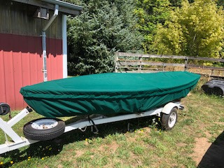 Snipe Sailboat Skirted Top Cover made in America by skilled artisans at SLO Sail and Canvas. Cover shown in Sunbrella Forest Green. Available in 3 fabrics and many color choices.
