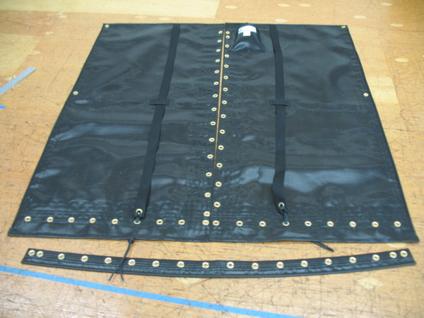 """Trampoline to fit an older Solcat 15 catamaran - made in America by skilled artisans at SLO Sail and Canvas. Hand pounded #4 brass spur grommets. Adjustable hiking straps made of 3"""" Polypropylene webbing. 12"""" X 12"""" halyard pocket, included. Built-in aft line catcher, included."""