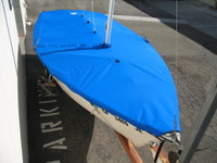"""Sailboat Mast Up Flat Mooring Cover made in America by skilled artisans at SLO Sail and Canvas. Cover shown in Sunbrella Forest Green. Available in 3 fabrics and many color choices. 1/4"""" shockcord is built into cover to secure your cover tightly around the boat's rubrail."""