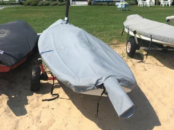 Pointer 14 Sailboat Hull Cover made in America by skilled artisans at SLO Sail and Canvas. Cover shown in Polyester Charcoal Gray. Available in 3 fabrics and many color choices.