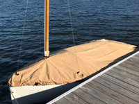 """Mooring Cover by SLO Sail and Canvas. 1/4"""" shockcord is built into cover to secure your cover tightly around the boat's rubrail. Web Loops allow you to """"tent"""" your cover up to prevent pooling of water. A mast collar and perfectly placed shroud cutouts fit tightly around your boat's rigging. All of our covers are patterned from the actual boats they are designed to fit. This make for a better, higher quality product."""