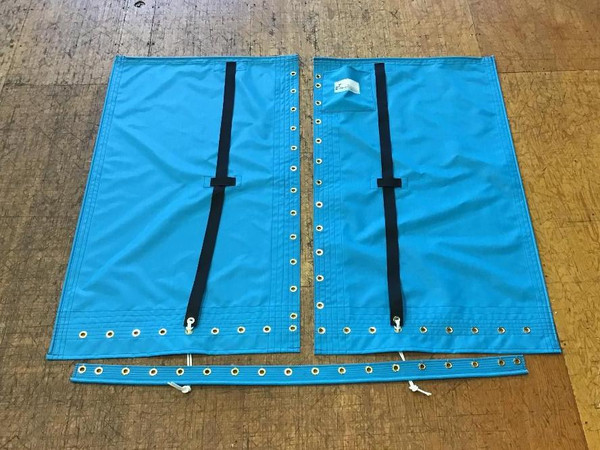 """3pc Trampoline to fit a Hobie 14 made in America by skilled artisans at SLO Sail and Canvas. Hand pounded #4 brass spur grommets. Adjustable hiking straps made of 2"""" polypropylene webbing. 12"""" X 12"""" Halyard pocket, included. Built-in aft line catcher, included."""