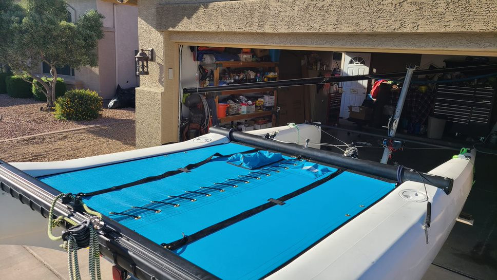 2pc Trampoline to fit a Hobie Getaway catamaran made in America by skilled artisans at SLO Sail and Canvas. Shown in Textilene 90 Lake Blue premium mesh. Optional Upgrade: Zipper Pocket shown