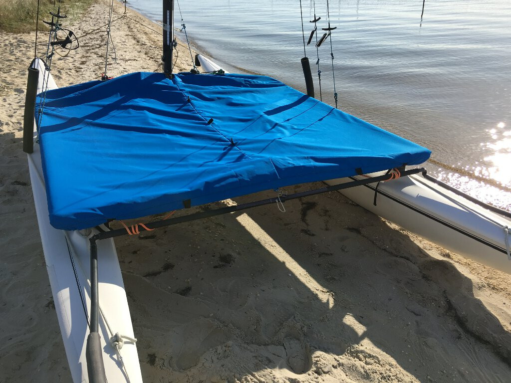"""The Trampoline Cover to fit a Hobie 16 fits tight around your trampoline frame with the help of a strap with Fastex buckle plus an adjustable 1/4"""" elastic shock cord."""