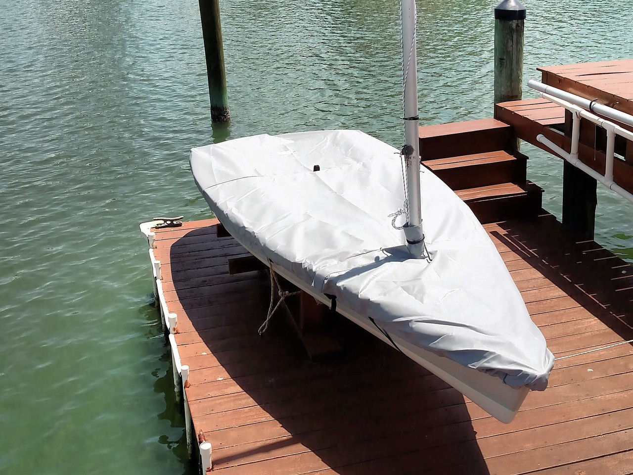 """Sailboat Hull Cover by SLO Sail and Canvas. 1/4"""" shockcord is built into cover to secure your cover tightly around the boat's rubrail. Web Loops allow you to """"tent"""" your cover up to prevent pooling of water."""
