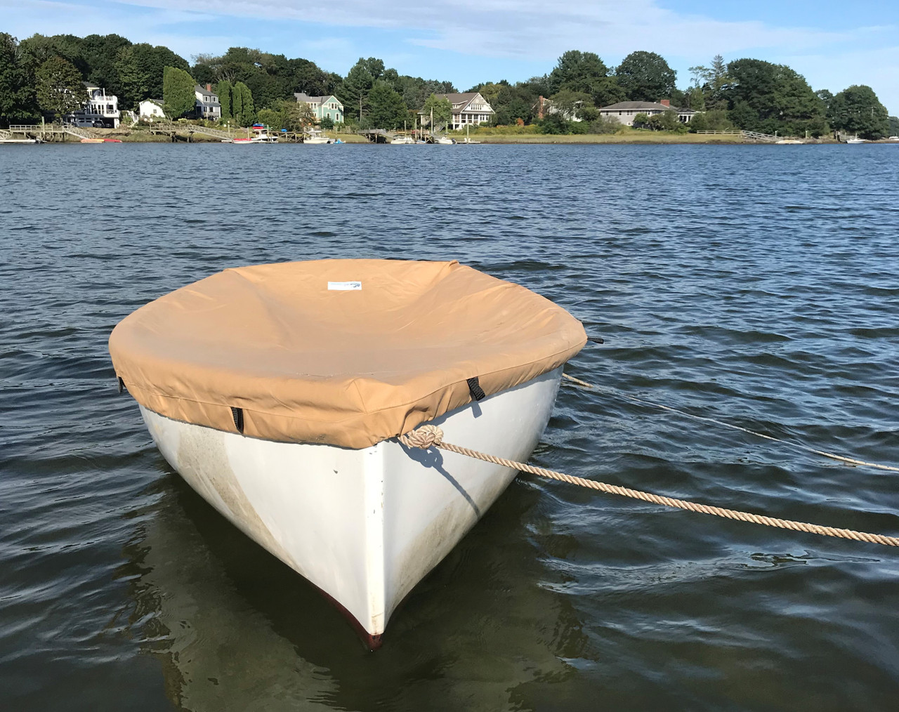 The Top Deck Boat Cover from SLO Sail and Canvas is custom tailored to perfectly fit your Dyer Dink 10 sailboat.