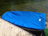 Vanguard Pram Sailboat Top Cover made in America by skilled artisans at SLO Sail and Canvas. Cover shown in Polyester Royal Blue. Available in 3 fabrics and many color choices.