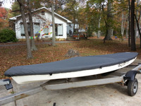 "Aqua Finn Deck Cover by SLO Sail and Canvas. 1/4"" shockcord is built into cover to secure your cover tightly around the boat's rubrail. Built in rudder gudgeon cutout. Cover your boat with or without rudder attached."