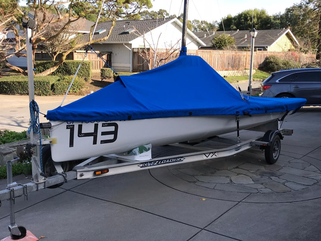 VX One Mast Up Peaked Mooring Cover by SLO Sail and Canvas.  Shown in Top Gun Caribbean Blue. Available in 3 fabrics and many color choices.