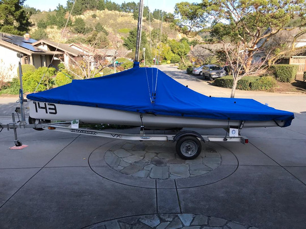 """VX One Mast Up Peaked Mooring Cover by SLO Sail and Canvas. 1/4"""" shockcord is built into cover to secure your cover tightly around the boat's rubrail. Web Loops allow you to """"tent"""" your cover up to prevent pooling of water. A mast collar and perfectly placed shroud cutouts fit tightly around your boat's rigging."""