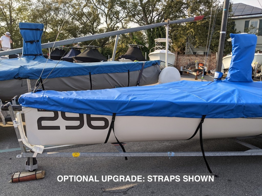 """VX One Sailboat Mast Up Flat Mooring Cover by SLO Sail and Canvas. Shown in Top Gun Caribbean Blue with optional """"Straps"""" upgrade."""