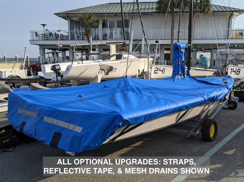 """VX One Sailboat Mast Up Flat Mooring Cover by SLO Sail and Canvas. Shown in Top Gun Caribbean Blue with optional """"Mesh Drains,"""" """"Straps,"""" and """"Reflective Tape"""" upgrades."""