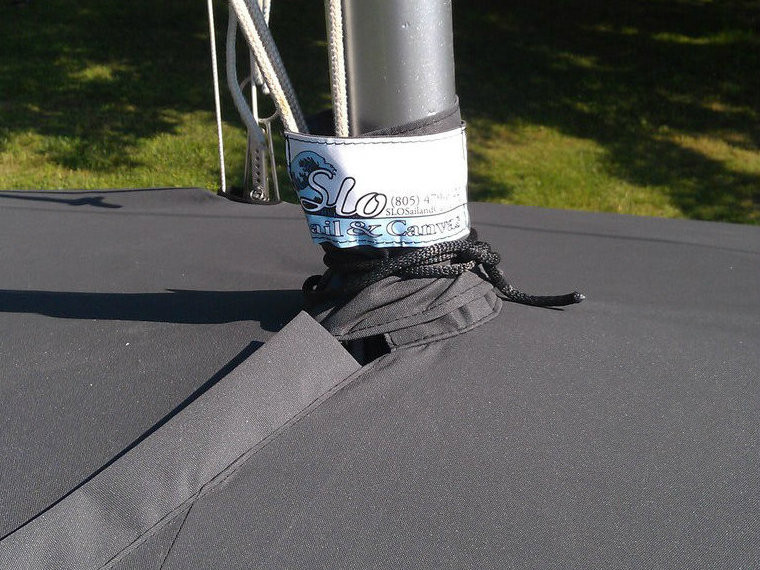 Mast Up Flat Cover by SLO Sail and Canvas. A mast collar and perfectly placed shroud cutouts fit tightly around your boat's rigging.
