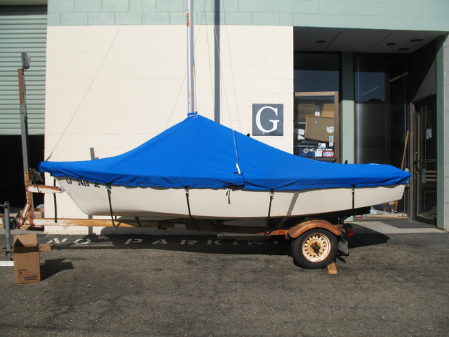 Blue Jay Cover in Polyester Top Gun or Sunbrella has sewn web loops to securely tie the cover down across the hull with bungee or parachute cord - or - our straps upgrade.