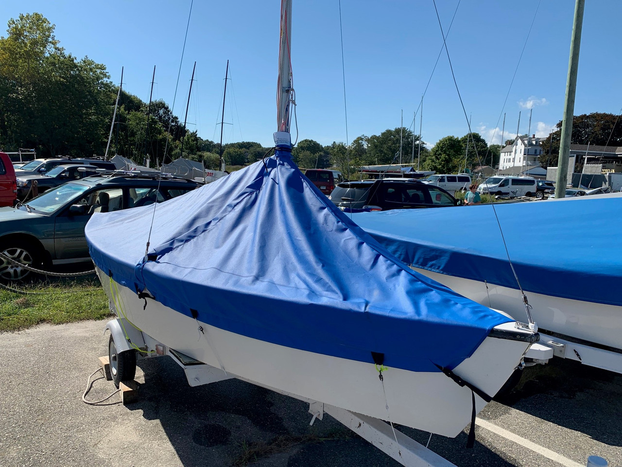 Our Blue Jay Mast Up Peaked Cover fits securely beneath the rub rail of your boat with a built in elastic band and optional straps.