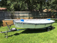 "Blue Jay Sailboat Hull Cover made in America by skilled artisans at SLO Sail and Canvas. 1/4"" shockcord is built into cover to secure your cover tightly around the boat's rubrail. Web Loops allow you to ""tent"" your cover up to prevent pooling of water."
