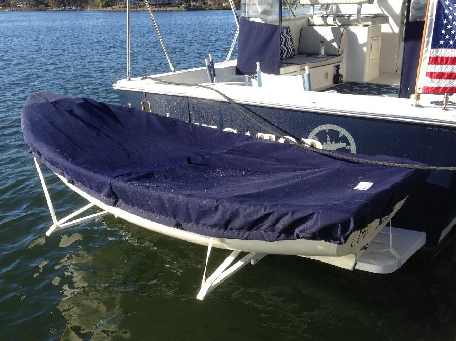 Trinka 10 Sailboat Hull Cover made in America by skilled artisans at SLO Sail and Canvas. Cover shown in Polyester Navy Blue. Available in 3 fabrics and many color choices.