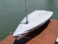"""Mast Up Flat Cover made in America by skilled artisans at SLO Sail and Canvas. 1/4"""" shockcord is built into cover to secure your cover tightly around the boat's rubrail. Web Loops allow you to """"tent"""" your cover up to prevent pooling of water."""
