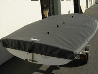 """420 Sailboat Top Cover made in America by skilled artisans at SLO Sail and Canvas. Web Loops allow you to """"tent"""" your cover up to prevent pooling of water. 1/4"""" shockcord is built into cover to secure your cover tightly around the boat's rubrail."""