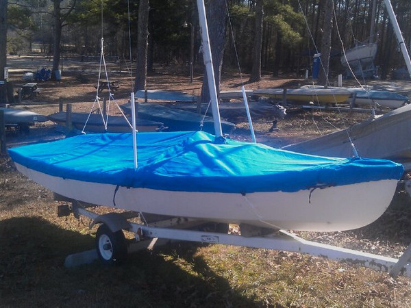 Sailboat Hull Cover made in America by skilled artisans at SLO Sail and Canvas. Cover shown in Sunbrella Pacific Blue. Available in 3 fabrics and many color choices.