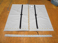 """3pc Vinyl Trampoline to fit a Hobie® catamaran made in America by skilled artisans at SLO Sail and Canvas. Hand pounded #4 brass spur grommets. Adjustable hiking straps made of 2"""" polypropylene webbing. 12"""" X 12"""" Halyard pocket, included. Built-in aft line catcher, included."""
