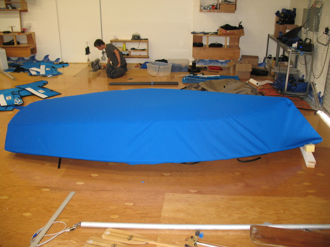 """Sailboat Hull Cover by SLO Sail and Canvas. 1/4"""" shockcord is built into cover to secure your cover tightly around the boat's rubrail."""