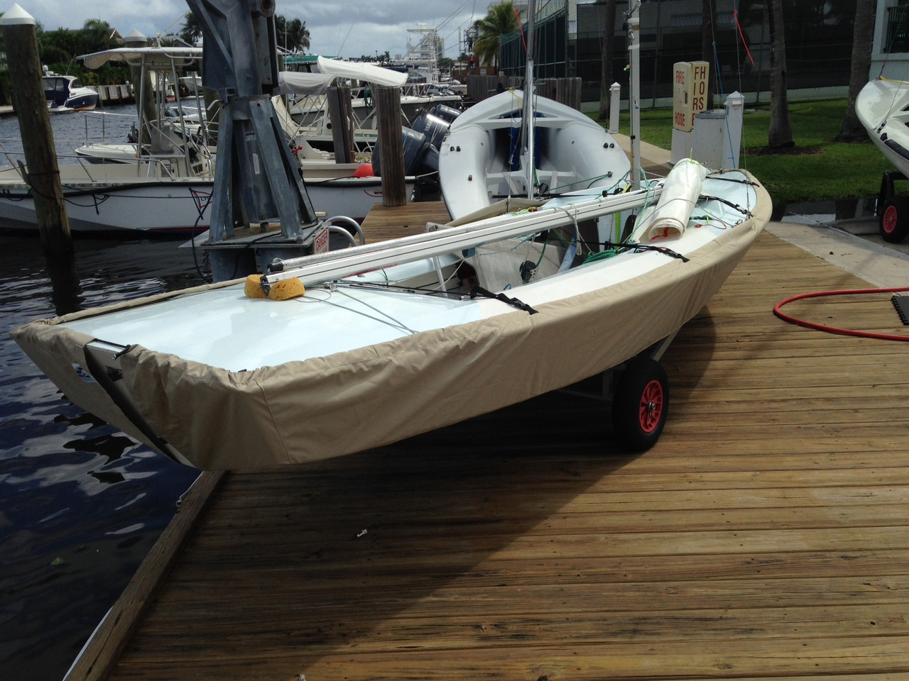"""Sailboat Hull Cover by SLO Sail and Canvas. 1/4"""" shockcord is built into cover to secure your cover tightly around the boat's rubrail. Choose either SPLIT or SOLID transom style."""