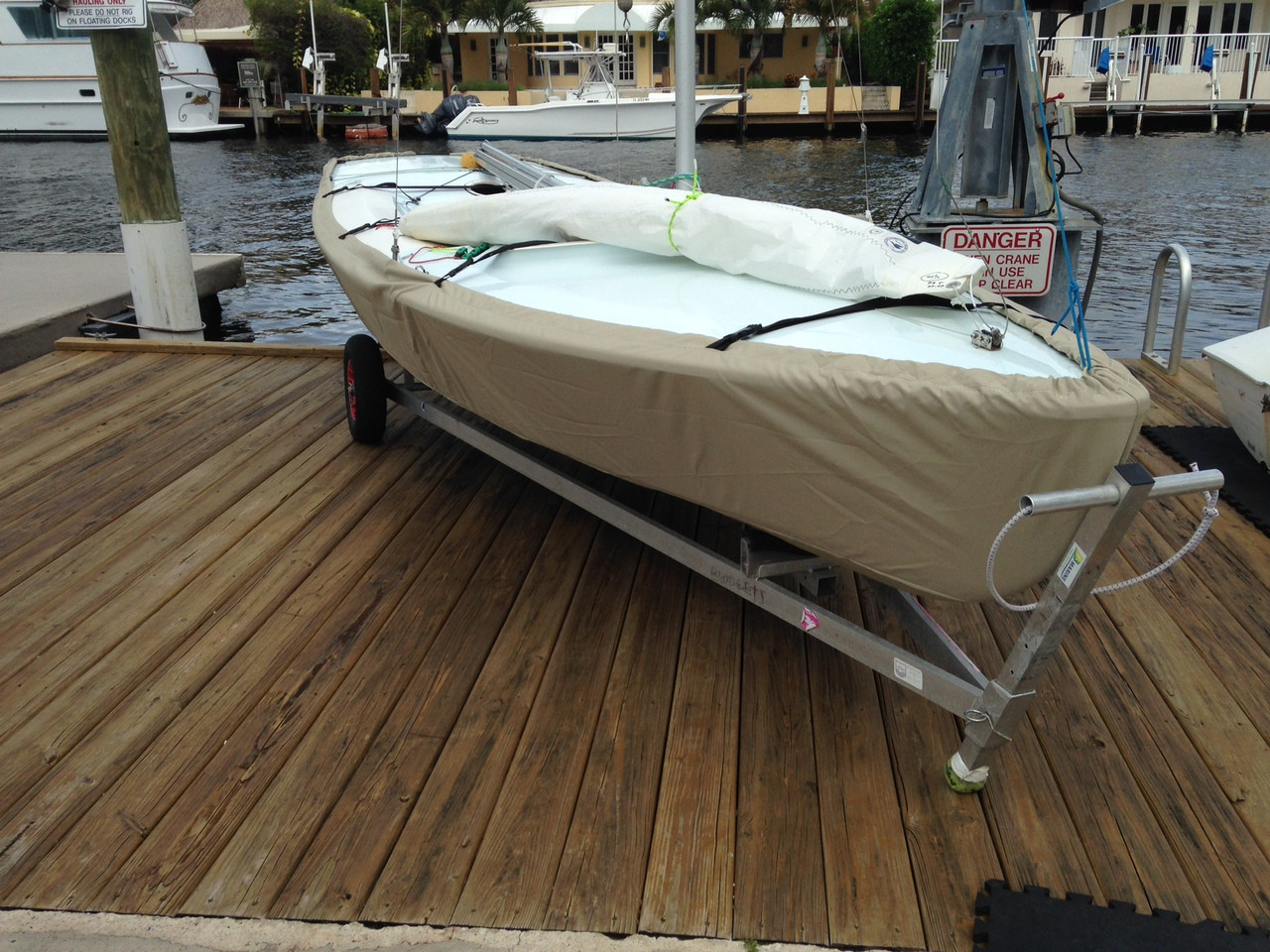 Sailboat Hull Cover made in America by skilled artisans at SLO Sail and Canvas. Cover shown in Sunbrella Toast. Available in 3 fabrics and many color choices.