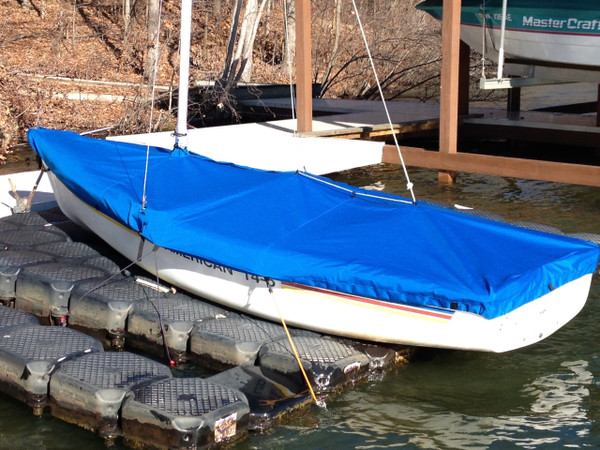 """American 14.6 Mast Up Flat Mooring Cover made in America by skilled artisans at SLO Sail and Canvas. 1/4"""" shockcord is built into cover to secure your cover tightly around the boat's rubrail. Web Loops allow you to """"tent"""" your cover up to prevent pooling of water.  A mast collar and perfectly placed shroud cutouts fit tightly around your boat's rigging. Reinforcements positioned over blocks and cleats prevent chafing. All of our covers are patterned from the actual boats they are designed to fit. This make for a better, higher quality product."""