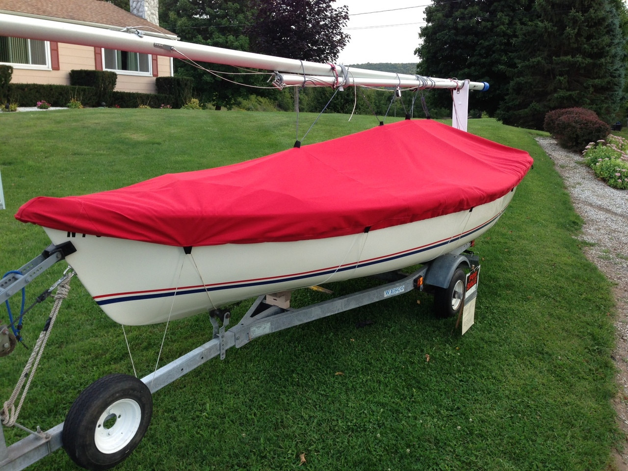 American 14.6 Top Deck Cover by SLO Sail and Canvas. Shown in Sunbrella Jockey Red.
