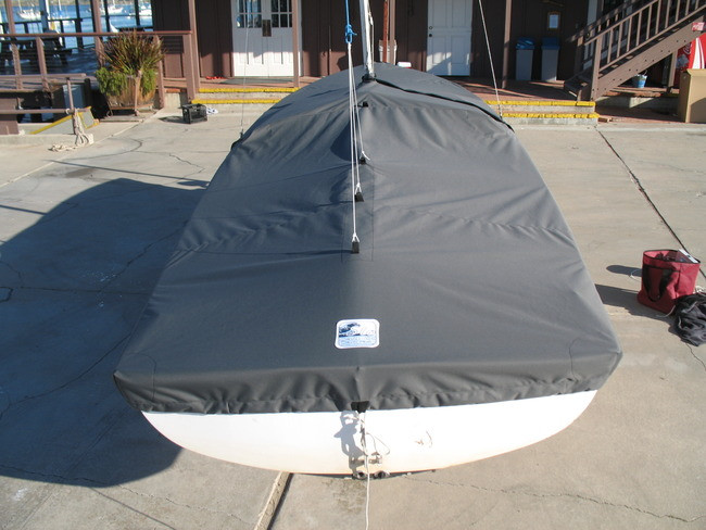 """Vanguard 15 Sailboat Mooring Cover by SLO Sail and Canvas. 1/4"""" shockcord is built into cover to secure your cover tightly around the boat's rubrail. Web Loops allow you to """"tent"""" your cover up to prevent pooling of water."""