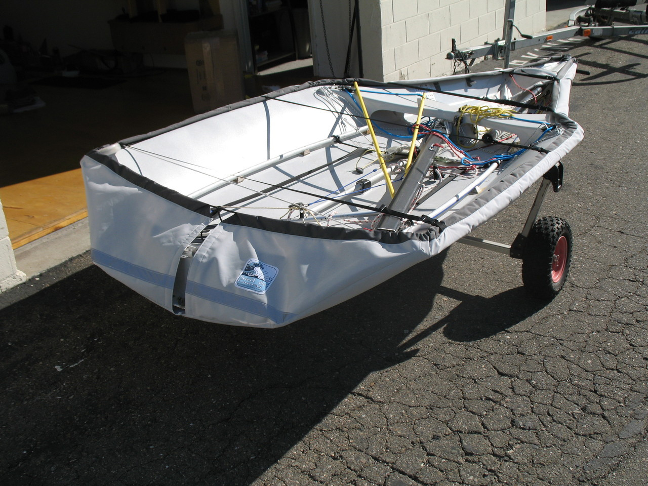29'er Sailboat Hull Cover by SLO Sail and Canvas. Straps - Standard Web Loops are replaced with polypropylene straps with plastic Fastex® buckles, included.