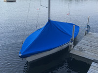 Vagabond 14 Sailboat Mast Up Peaked Mooring Cover made in America by skilled artisans at SLO Sail and Canvas.