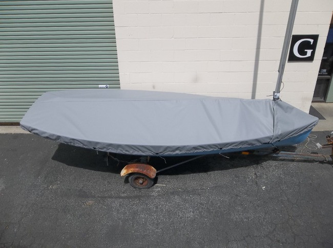 Finn sailboat Mast Up Peaked Mooring Cover by SLO Sail and Canvas. Reinforcements positioned over blocks and cleats prevent chafing. Webbing loops are sewn around the perimeter of our top covers allowing your cover to be tied to your boat.
