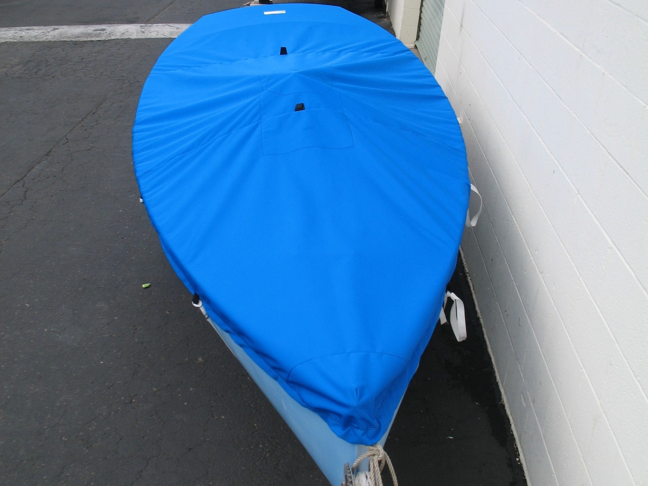 Finn sailboat Top Cover by SLO Sail and Canvas. Reinforcements positioned over blocks and cleats to prevent chafing. Webbing loops are sewn around the perimeter of our top covers allowing your cover to be tied to your boat.