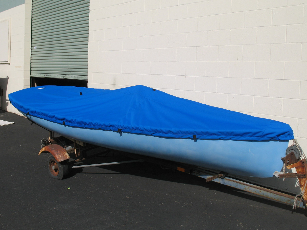 Finn sailboat Top Cover by SLO Sail and Canvas shown in Polyester Royal Blue. Available in 3 fabrics and many color choices.